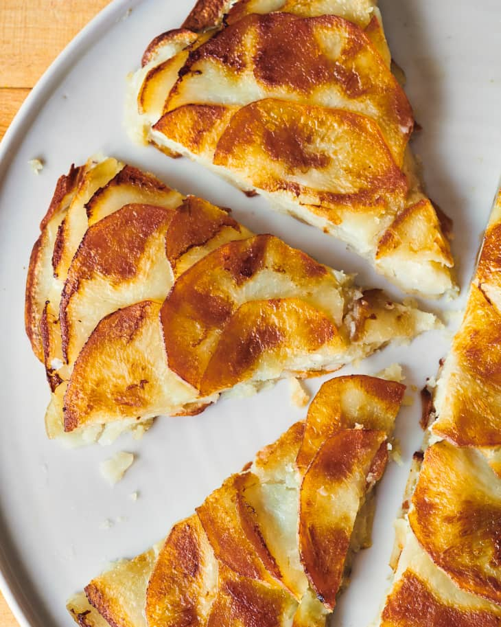 triangle slices of pommes anna on a plate