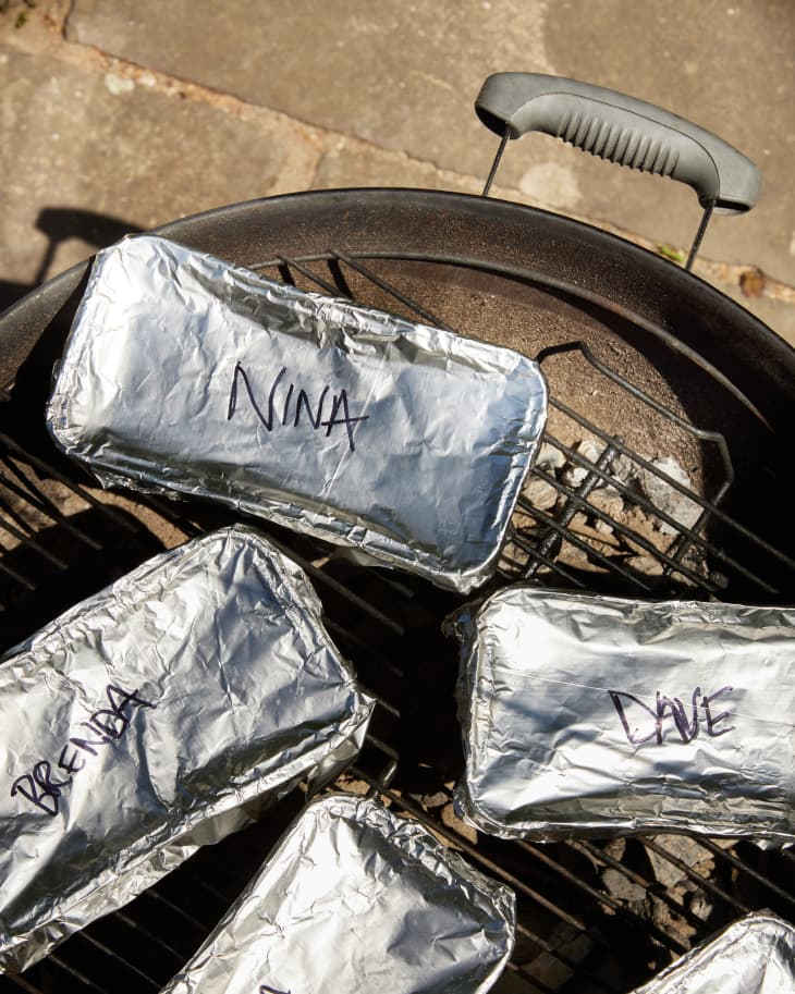 tins covered, cooking on grill