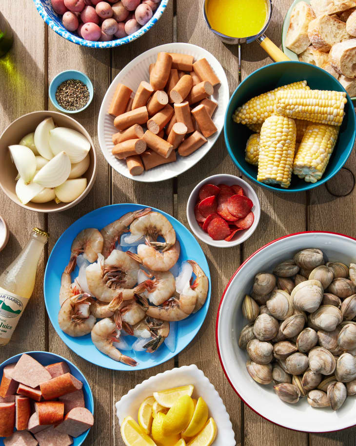 ingredients to make clam boil on a table