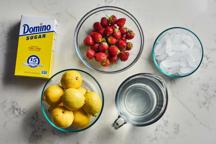 ingredients to strawberry lemonade on a table