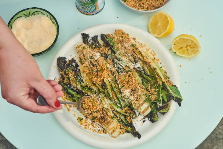 Grilled romaine salad served.