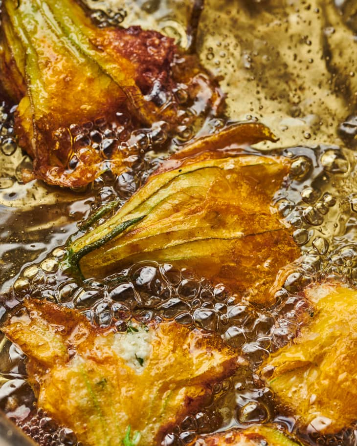 squash blossoms in fryer oil