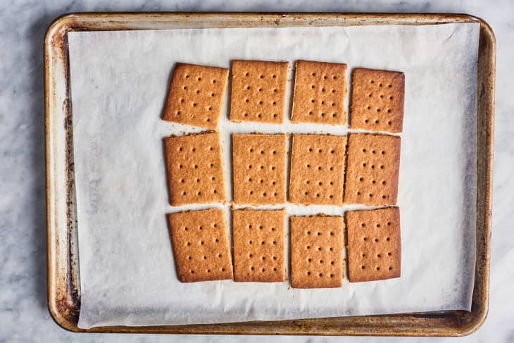 graham crackers sliced on parchment paper